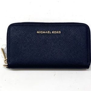 Michael Kors round zip wallet